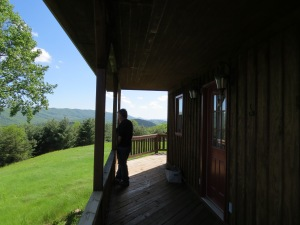 Tony on front porch of cabin