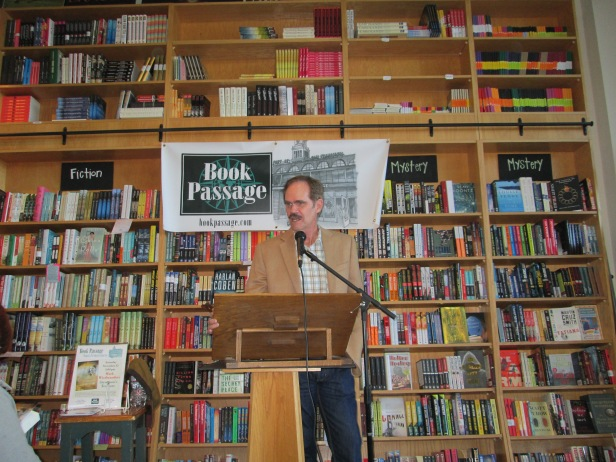 Mark W with bookshelves