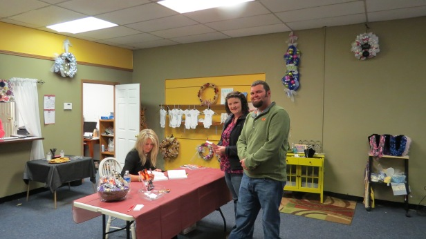 Author Renee Johnson signing copies of her novel Acquisition