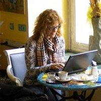 Karen writing in a café in Kranj, Slovenia