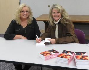 Signing a copy for Jayne Bauguess